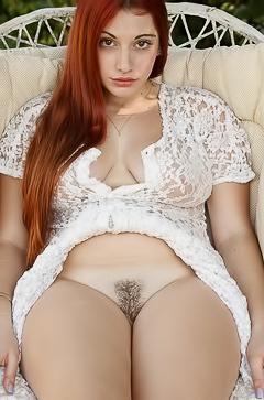 Busty redhead Gina Rosini
