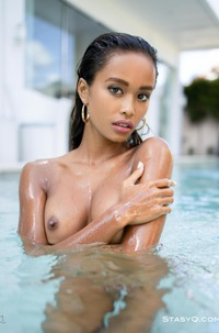 Big Boobed Latin Model PutriQ In Th Pool
