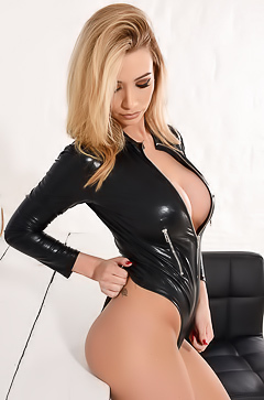 Dani Anderson stripping latex jacket