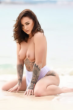 Mica Martinez - topless on beach