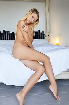 Lisa Dawn Alone in bed, this beautiful blonde spreads her pussy