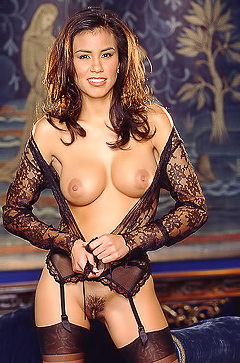 Brianna Bailey is a busty brunette in lace lingerie
