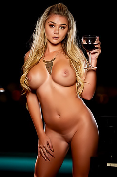 Tahlia Paris shows off her huge tits while enjoying some wine