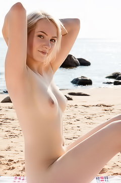 Beach blonde babe gets naked