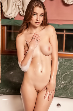 Redhead Mary Jane is soap, wet, and sexy in the tub