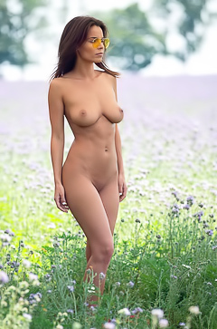 Natalie Costello plays naked in a field of flowers