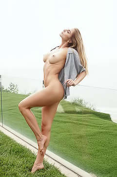 Kenzie Anne posing sensually for the camera almost completely nude